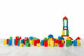 Building blocks toy over floor in white interior Stock Photos
