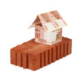 Building on a brick of russian rubles banknotes foundation Stock Photo