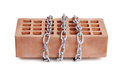 Building bricks, wrapped in steel chain Stock Photography