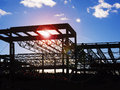 Building construction site new commercial back lit by sun with lens flare as a design element Royalty Free Stock Photography