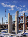 Building construction site new commercial with cement beams in foreground Royalty Free Stock Images