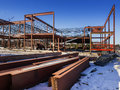 Building construction site new commercial with steel beams in foreground Royalty Free Stock Photography