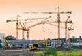 Building construction site with tower crane machinery Royalty Free Stock Photo