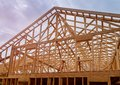 Building construction, wood framing new home under construction roof being built Royalty Free Stock Photo