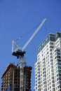 Building crane in highrise Royalty Free Stock Image