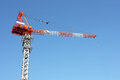Building crane jib against a clear blue sky Royalty Free Stock Images