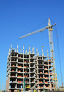 Building cranes on construction site with builders. Building high rise.Crane Construction. Tower Crane and Building Constructors