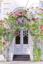 Building entrance with red roses Royalty Free Stock Photo