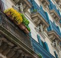 Building facade with balconies beautiful balcony full of flowers Stock Images