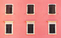 Building facade and old windows with classic wooden shutters bli Royalty Free Stock Photo