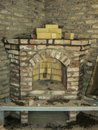 Building a fireplace in a house using old bricks. Beautiful bricklaying Royalty Free Stock Photo