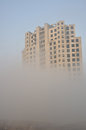 Building in the fog bulding under construction morning Stock Image