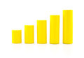 building a growing financial graph using yellow color wood toy.