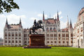 The building of the Hungarian parliament. Front view left wing. Statue of rider on horseback.