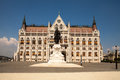 The building of the Hungarian parliament. Front view left wing. Statue of rider on horseback.The building of the Hungarian