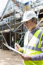 Building Inspector Looking At House Renovation Project Royalty Free Stock Photo