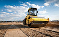 Building lot with caterpillar Royalty Free Stock Images