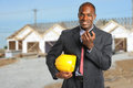 Building manager at construction site african american using radio Stock Image