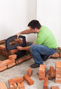 Building a masonry heater worker dimensioning the fire box Royalty Free Stock Image