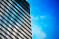 Building mirror glass wall reflecting blue sky Stock Photo