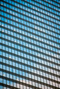 Building mirror glass wall reflecting blue sky Royalty Free Stock Images