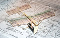 Building a model airplane balsa wood plane sits on blueprints and instructions Stock Photo