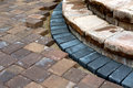 Building patio steps progress on brown brick with contrasting bluish color bricks Stock Photos