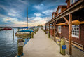 Building and pier at sunset, on the Potomac River waterfront, in Royalty Free Stock Photo