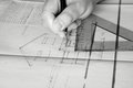 Building plans being drawn B Royalty Free Stock Photography