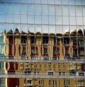 Building reflected in glass panels Royalty Free Stock Image