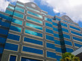 Building with reflection of blue sky and clouds Stock Images