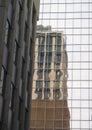 Building reflection in glass sky scraper Stock Image