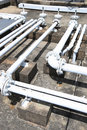 Building rooftop pipelines Royalty Free Stock Photo