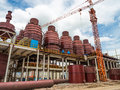 Building structure in factory steel of poles and large tanks Royalty Free Stock Photography