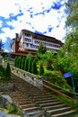 Building on top stairway climbing to new hotel perched hilltop at bulgarian rhodopes mountains shiroka laka village Stock Photos