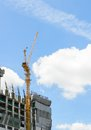 Building under construction with blue sky background crane and Royalty Free Stock Image