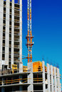 Building under construction with crane Royalty Free Stock Image