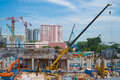 Building under construction with cranes Royalty Free Stock Photo
