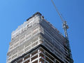 Building under construction structure of a and a crane working Royalty Free Stock Images