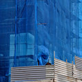 Building under debris netting at construction site Royalty Free Stock Image