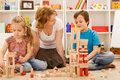 Building with wooden blocks together is fun Royalty Free Stock Photo