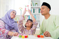 Building a wooden toy house malay family at home muslim girl southeast asian parents and child living lifestyle Stock Image