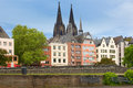 Buildings along an embankment in cologne and the high cathedral of st peter germany Royalty Free Stock Images