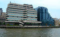 Buildings along thames in london modern architecture the river uk Stock Photography