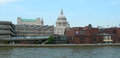 Buildings along thames in london modern and classic architecture with st pauls cathedral as background the river uk Stock Photography
