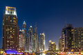 Buildings in dubai marina nightview is an artificial canal city built along a two mile km stretch of persian gulf shoreline Stock Photos