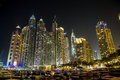 Buildings in dubai marina nightview is an artificial canal city built along a two mile km stretch of persian gulf shoreline Stock Photography
