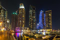 Buildings in dubai marina nightview is an artificial canal city built along a two mile km stretch of persian gulf shoreline Royalty Free Stock Photos