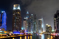 Buildings in dubai marina nightview is an artificial canal city built along a two mile km stretch of persian gulf shoreline Stock Image