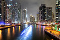 Buildings in dubai marina nightview is an artificial canal city built along a two mile km stretch of persian gulf shoreline Stock Photo